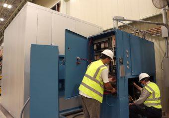 Alltest technicians installing environmental chamber